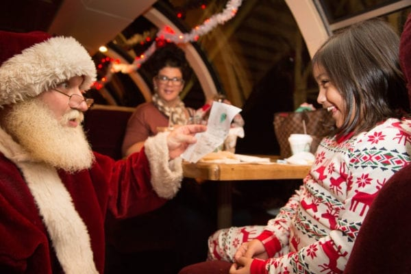 Little Girl with Santa at Table Reading List