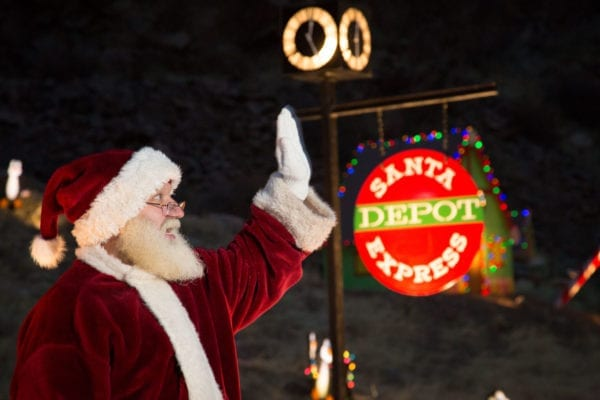 santa waving at santa express in north pole